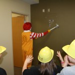 Ronald McDonald breaks down the wall