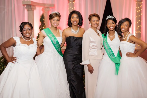 Debutantes with Ronetta Francis, President of Phi Alpha Omega Chapter, and Cora B. Davis, President of Tea Rose Foundation