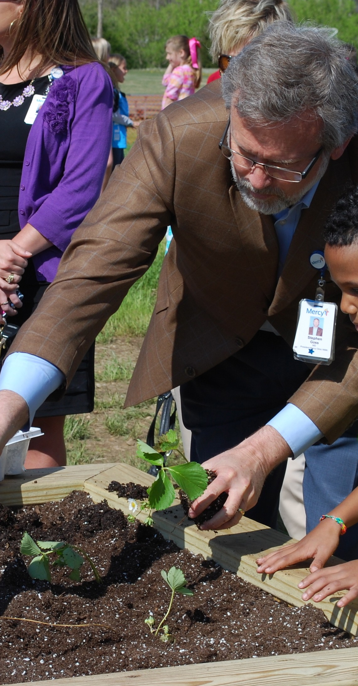 "Mercy and Cooper Elementary Hold ""First Plant"" of Community Garden"