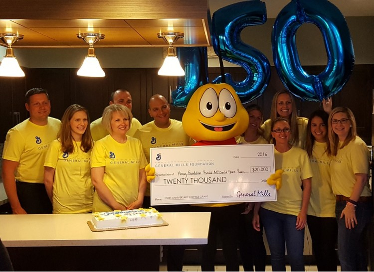 BuzzBee and the General Mills prize patrol with the $20,000 donation check  Photo courtesy of KNWA and Mercy Hospital