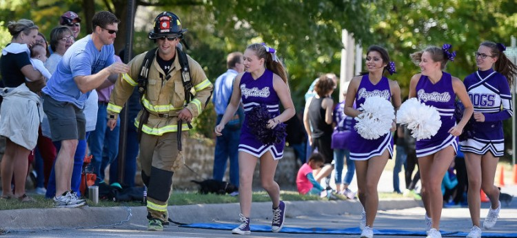 Spectators and FHS cheerleaders motivate a firefighter during the hardest portion of the marathon