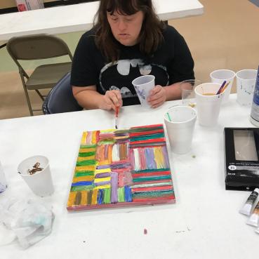 Sunshine School & Development Center Community Support Client Paints Artwork used on 2020 3W Magazine cover