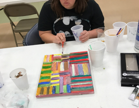 Sunshine School & Development Center Community Support Client Paints Artwork used on 2020 3W Magazine cover